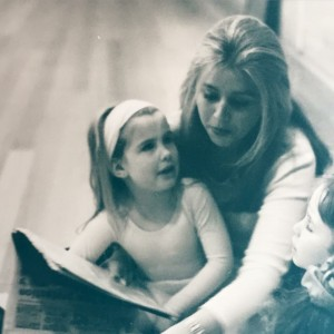 Emily reading to student